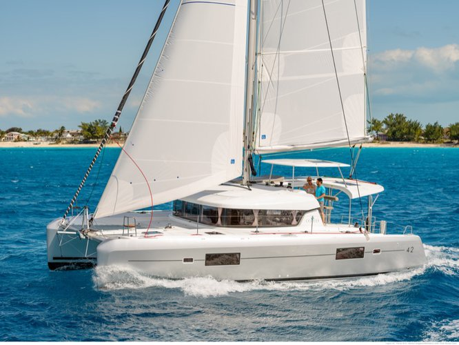Sail the beautiful waters of Furnari on this cozy Lagoon Lagoon 42 (Gen+A/C+WM)