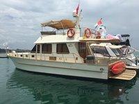 Enjoy Singapore on board this beautiful motor yacht