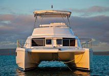 Enjoy in the sun on this Sentosa catamaran charter