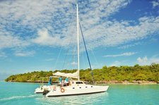 Experience Trou d'Eau Douce on board this elegant catamaran