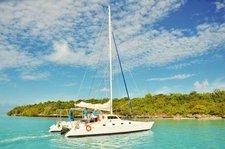 Experience Trou d'Eau Douce on board this elegant catamaran