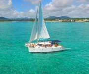 Discover Trou d'Eau Douce in style boating on this sailing catamaran rental