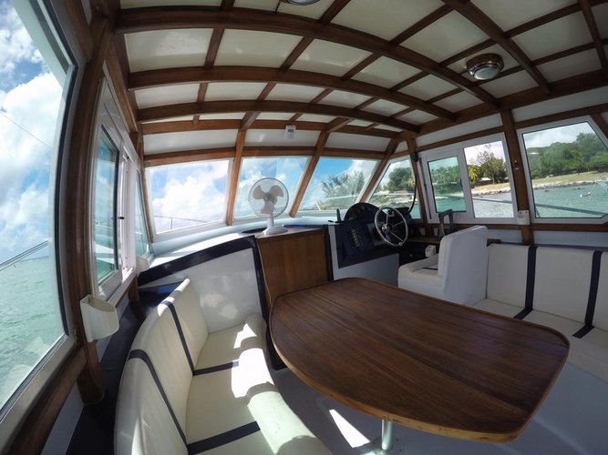 Discover Flic En Flac surroundings on this Custom Custom boat