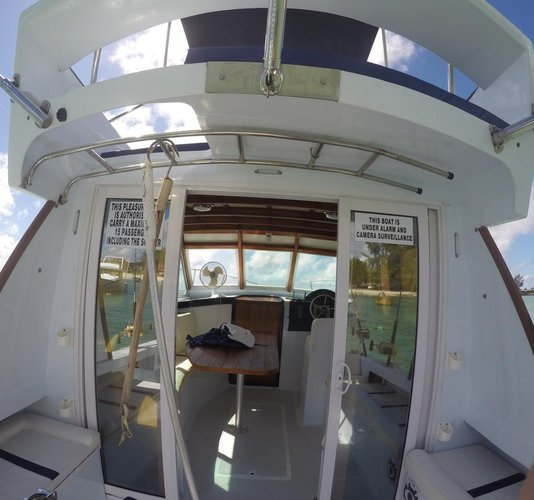 Up to 7 persons can enjoy a ride on this Cuddy cabin boat