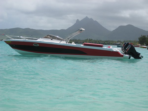 Discover Trou D´Eau Douce surroundings on this Custom Custom boat