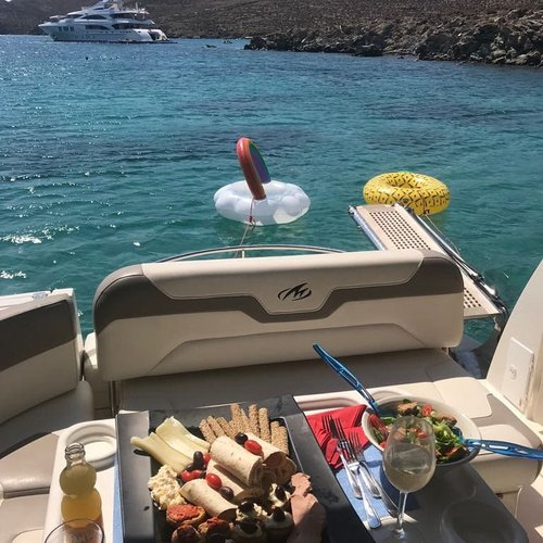 Discover Mykonos surroundings on this 335SY Monterey boat