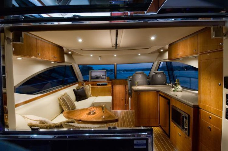 Discover Sydney surroundings on this Custom Riviera boat