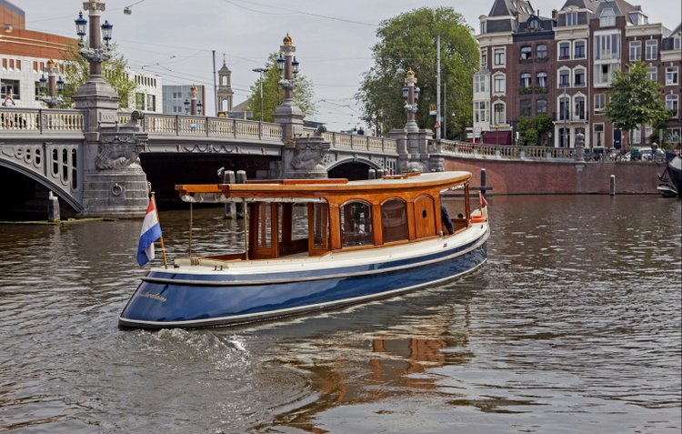 Enjoy luxury and comfort on this Amsterdam electric boat rental