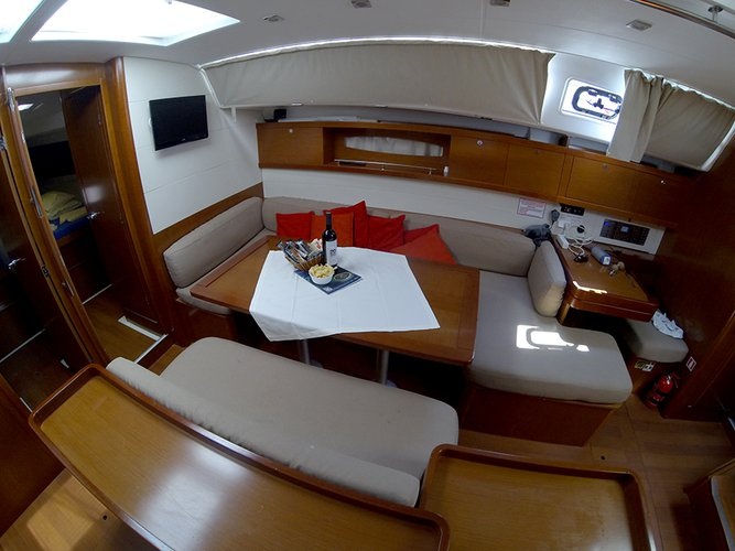 Up to 13 persons can enjoy a ride on this Beneteau boat