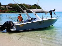 Relax on board our motor boat charter in Black River, Mauritius.