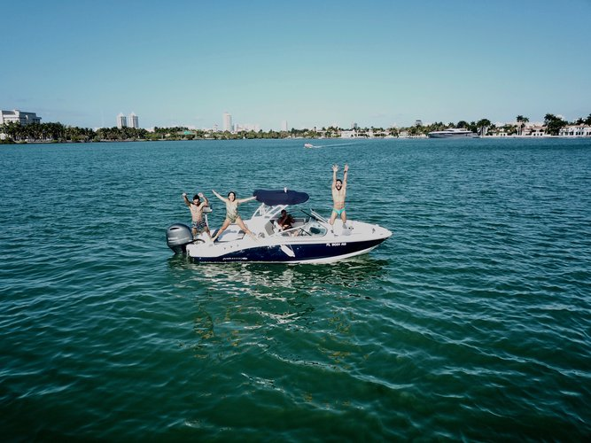 Discover Key Biscayne surroundings on this H2O 21FT Chaparral boat