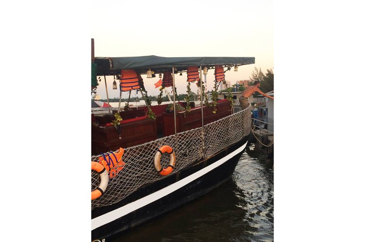 Discover Ho Chi Minh City surroundings on this Custom Custom boat