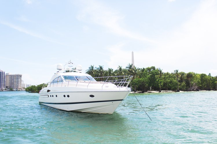 Discover Miami Beach surroundings on this 65V Princess boat