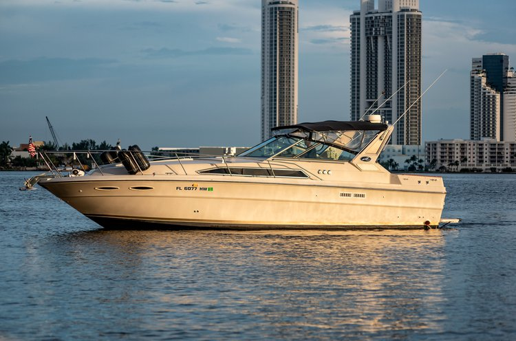 Discover Miami surroundings on this express cruiser sears boat