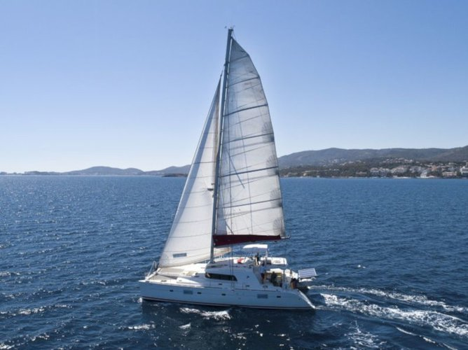 Sail the beautiful waters of Palma de Mallorca on this cozy Lagoon Lagoon 500