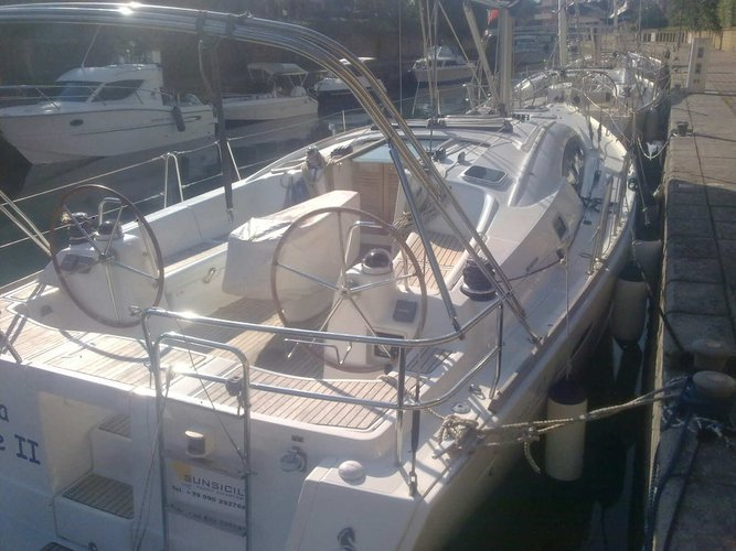 Discover Furnari in style boating on this sailboat rental