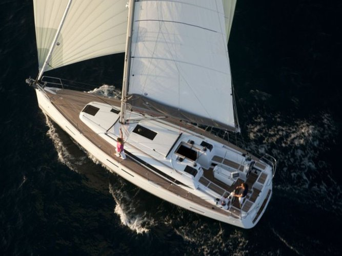 Sail the beautiful waters of Portocolom on this cozy Jeanneau Sun Odyssey 409