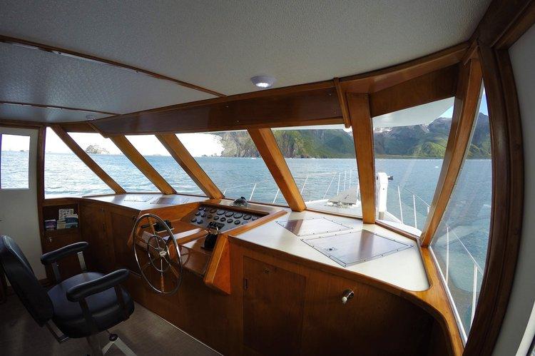 Discover Seward surroundings on this 65 Bertram boat