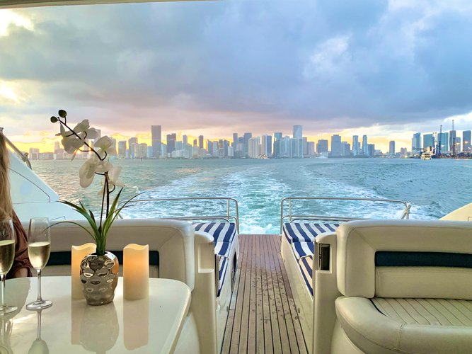 Discover Miami Beach surroundings on this V65 Princess boat