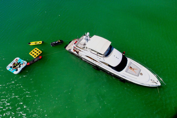 Discover Miami Beach surroundings on this 65 Princess boat