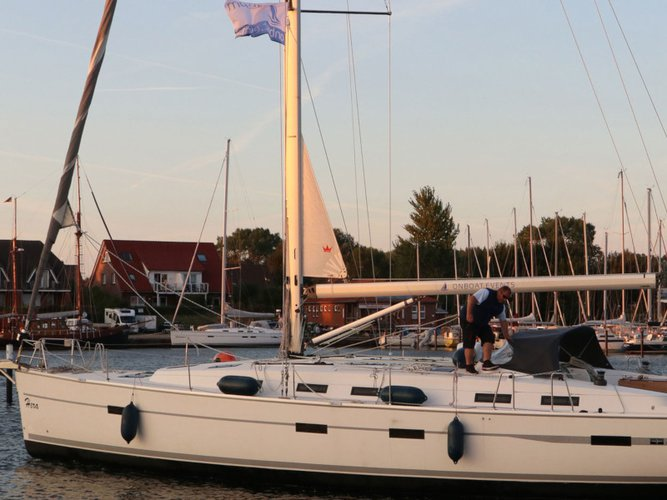 Sail the beautiful waters of Lemmer on this cozy Bavaria Yachtbau Bavaria Cruiser 50