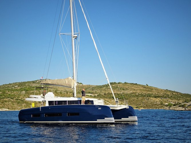 Sail the beautiful waters of Primošten on this cozy Dufour Yachts Dufour 48 Catamaran
