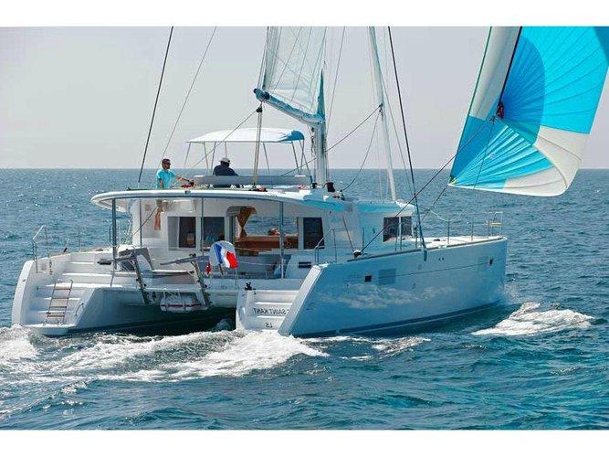 Sail the beautiful waters of Ibiza - Sant Antoni de Portmany on this cozy Lagoon Lagoon 450 Sport