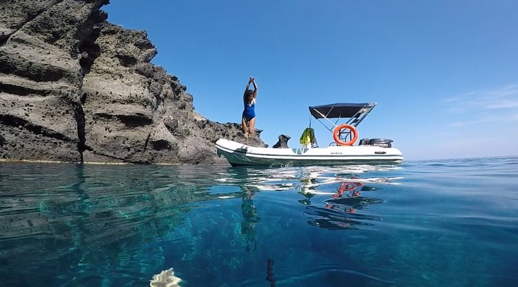 Discover Santorini - Vlichada surroundings on this Ondina 565 Nautica boat