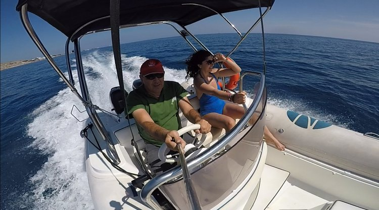 Inflatable outboard boat rental in Vlichada port, Greece