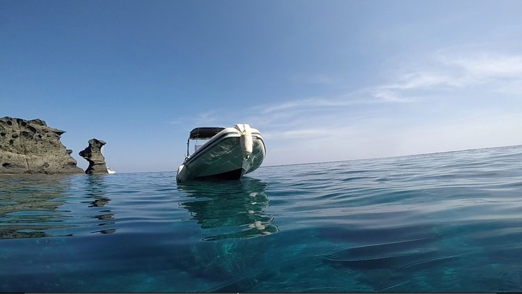 Boating is fun with a Inflatable outboard in Santorini - Vlichada