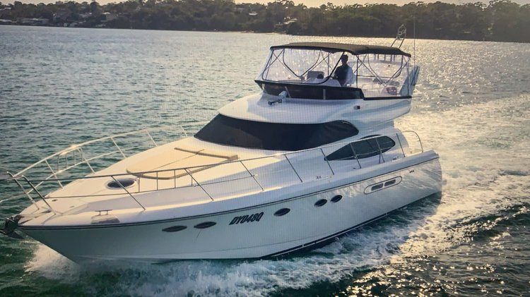 Discover Hallandale Beach surroundings on this 50' DYNACRAFT boat