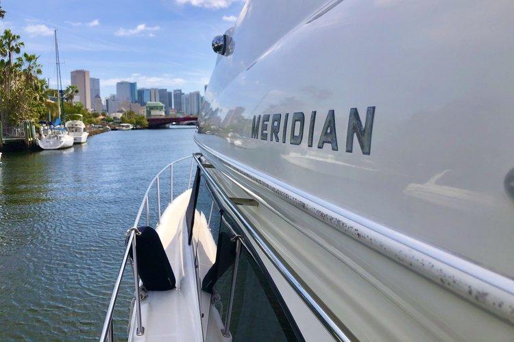 Discover Miami surroundings on this Meridian Yachts 411 Sedan Meridean boat