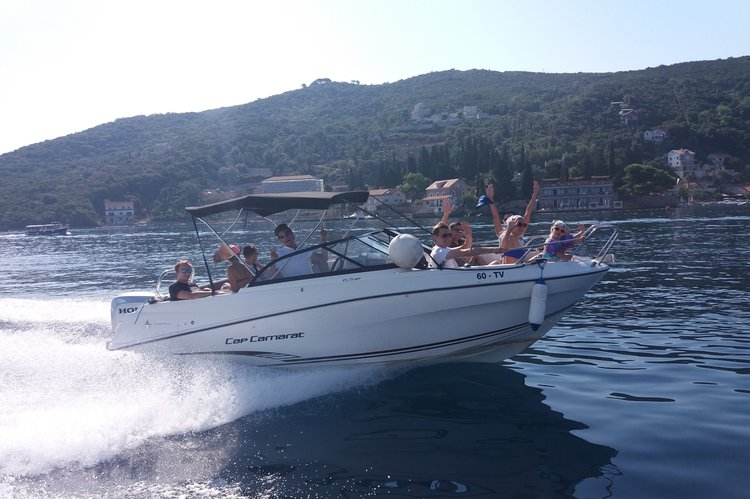 Discover kotor surroundings on this Cap Camarat 6.5 CC Jeanneau boat