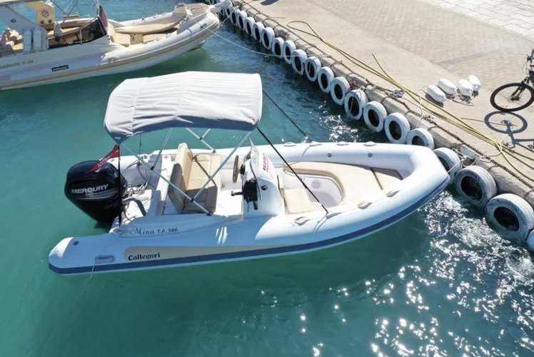 Inflatable outboard boat rental in Nydri Port, Greece