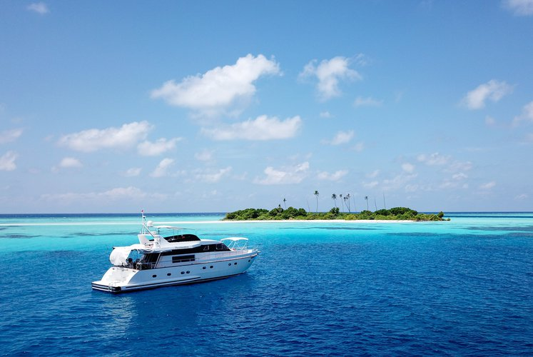 Discover Male surroundings on this 65' FALCON boat