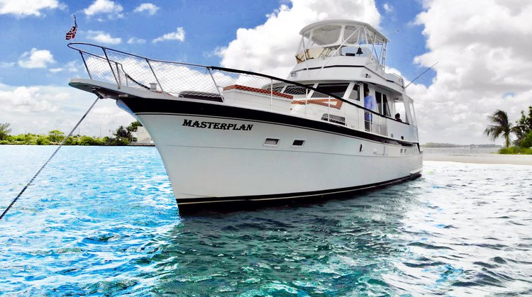 Discover Miami surroundings on this 60 Yacht Hatteras boat