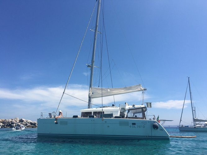 Sail the beautiful waters of Punta Ala on this cozy Lagoon Lagoon 450