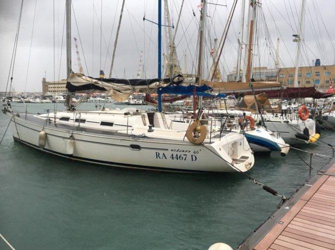 Sail the beautiful waters of Genova on this cozy Elan Elan 40