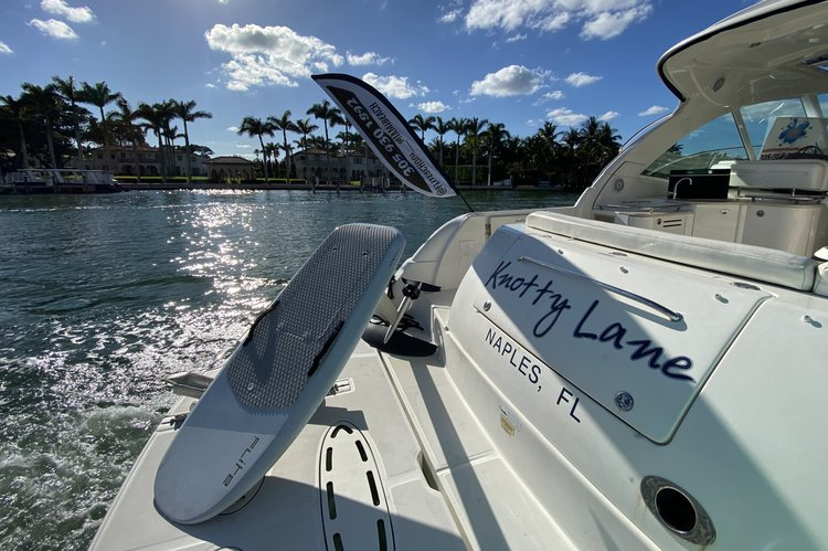 Discover Miami Beach surroundings on this Sundancer Sea Ray boat
