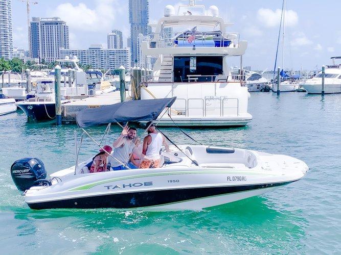 Discover Miami surroundings on this 1950 Tahoe boat
