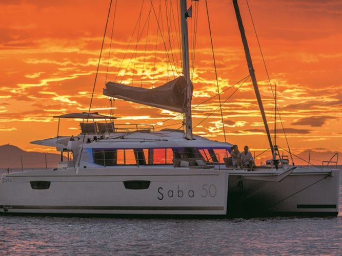 Sail the beautiful waters of Capo d'Orlando on this cozy Fountaine Pajot Saba 50