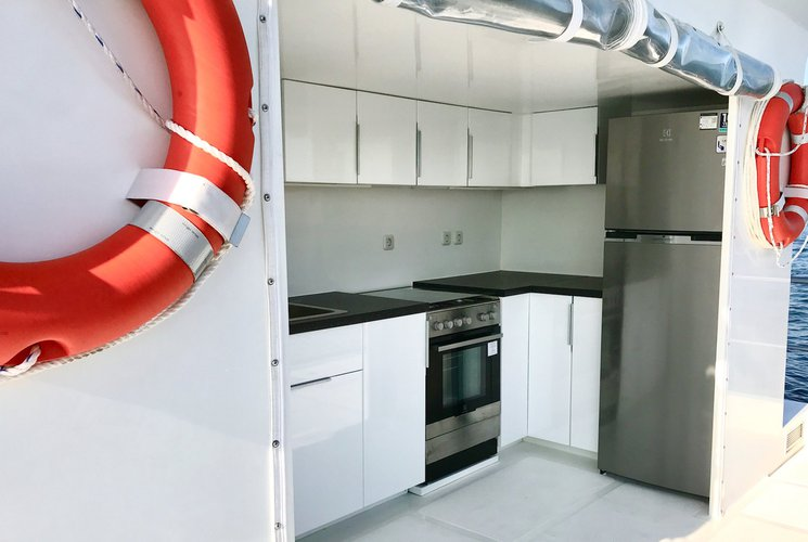 Up to 4 persons can enjoy a ride on this Catamaran boat