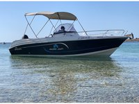 Discover Ibiza in style boating on this motor boat rental