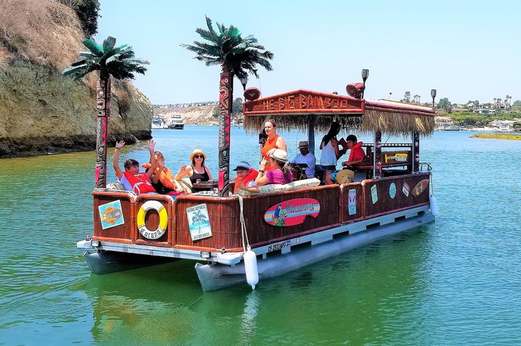 Tiki style pontoon boat for rent in Newport Harbor