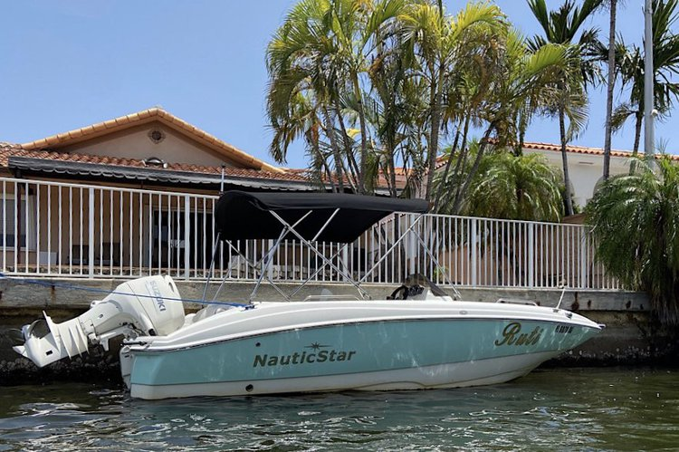 Discover Sunny Isles Beach surroundings on this 193 SC Nautic Star boat