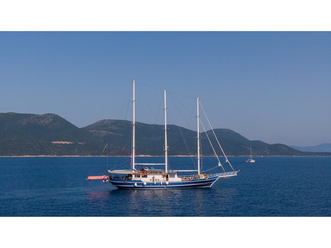 Sail the beautiful waters of Mykonos on this cozy  Gulet Artemis