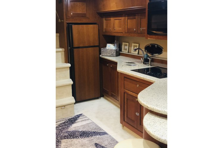 Discover Sunny Isles Beach surroundings on this 5470 Cruisers Yacht boat