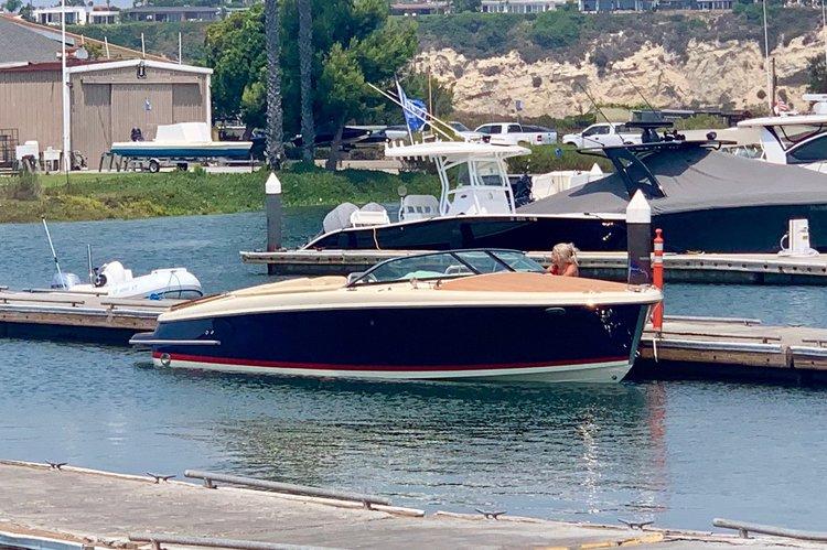Discover Newport Beach surroundings on this Capri Chris Craft boat
