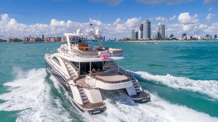 Discover Miami Beach surroundings on this F62 Cat boat