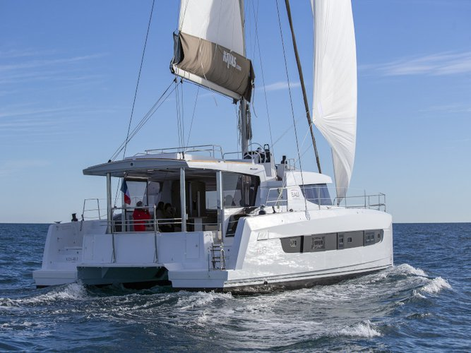 Explore Barcelona on this beautiful sailboat for rent